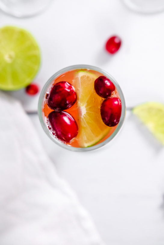 Overhead shot of one of the holiday mimosas with cranberries