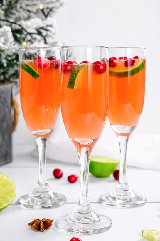 This is a super festive Holiday Mimosas recipe for whether you're hosting a holiday brunch or an elegant holiday party that will brighten everyone's holiday!