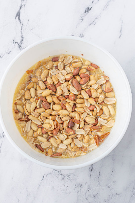 Adding the roasted peanuts needed to make the Microwave Peanut Brittle recipe