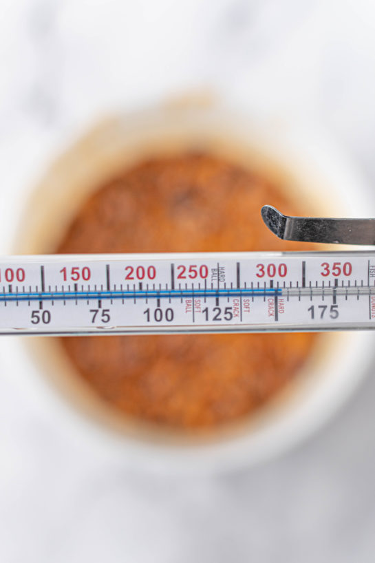 Using the candy thermometer needed to make the Microwave Peanut Brittle recipe