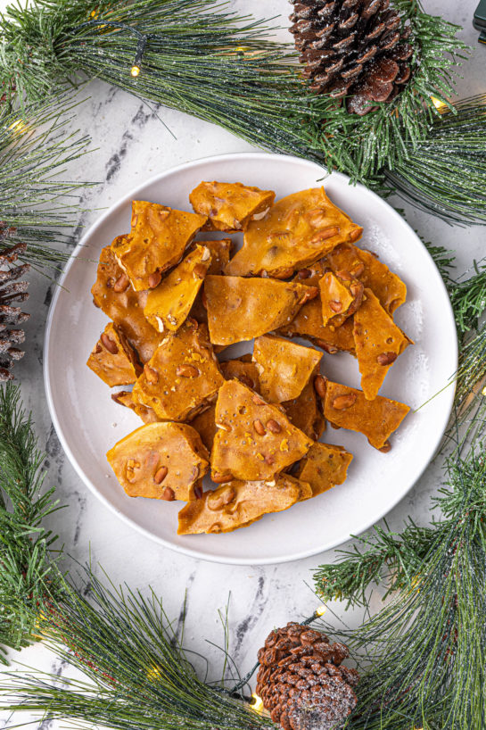 Perfect golden brown Microwave Peanut Brittle recipe is the perfect sweet & salty treat for the holidays with the perfect crunch and sheen! A great edible gift for Christmas!