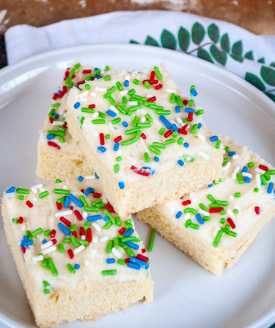 The Holiday Sugar Cookie Bars all cut up and on a plate for serving
