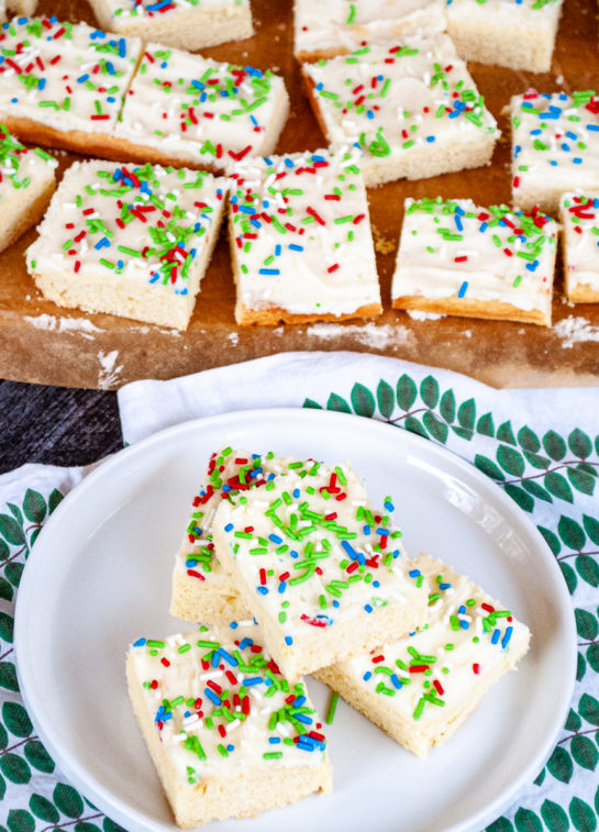 Overhead shot of the Holiday Sugar Cookie Bars cut up and on a plate for serving