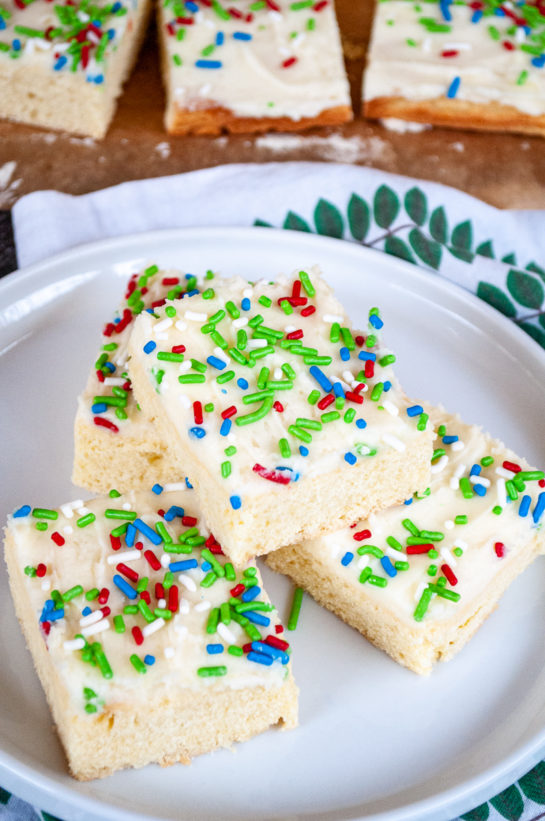 Overhead shot of the Holiday Sugar Cookie Bars cut up and on a plate for serving for Christmas or any holiday