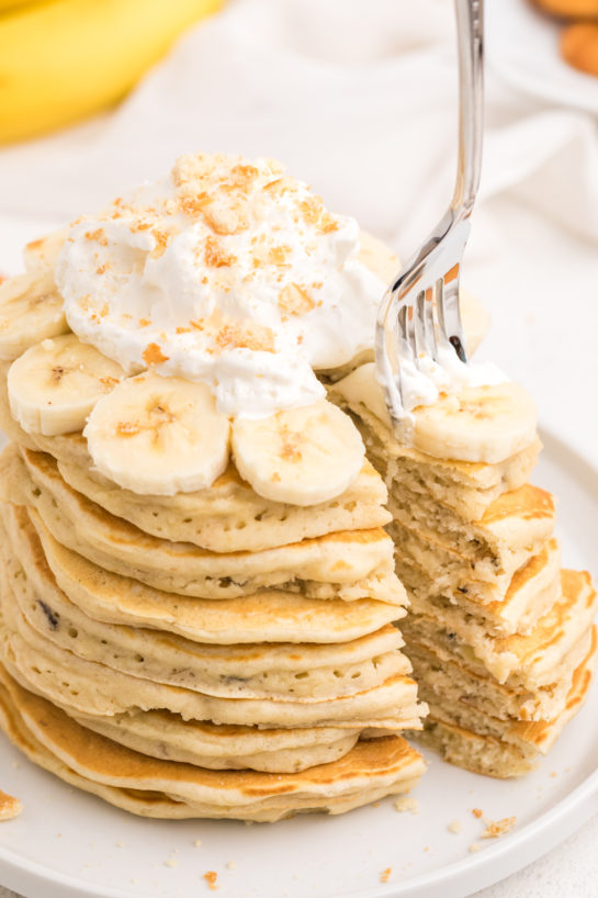 Close up of eating the Banana Pudding Pancakes that are flavorful enough you don't even need the syrup! They are a quick and easy breakfast or brunch recipe you will love!