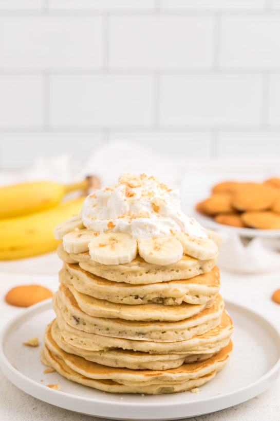Delicious Banana Pudding Pancakes are flavorful enough you don't even need the syrup! They are a quick and easy breakfast or brunch recipe you will love!