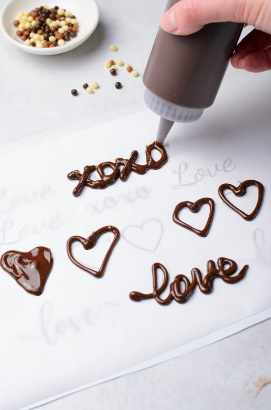 Writing out words in chocolate for the Valentine's Day Lover's Chocolate Cupcakes recipe