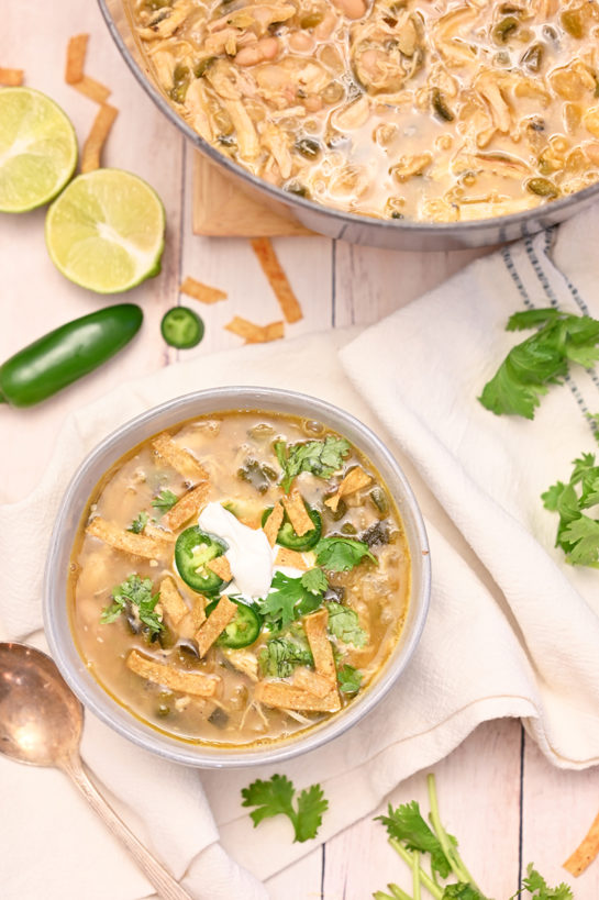 Warm, comforting White Chicken Chili recipeis a flavorful blend of tender chicken, white beans and just enough spice! This is my new favorite chili recipe for game day, holiday, or cold winter day!
