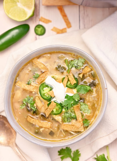 Easy White Chicken Chili recipeflavorful blend of tender chicken, white beans and just enough spice! This is my new favorite chili recipe for a cold winter day!