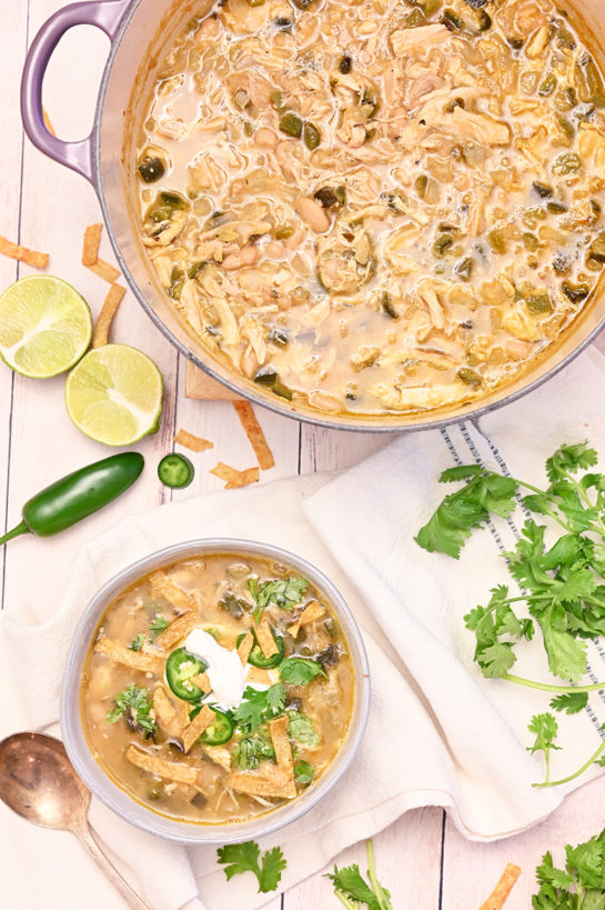 Comforting White Chicken Chili recipe flavorful blend of tender chicken, white beans and just enough spice! This is my new favorite chili recipe for game day, holiday, or cold winter day!