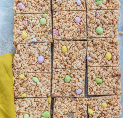 Photo of the cut-up Mini Egg Rice Krispie Treats that are a deliciously addictive dessert recipe for Easter! They're super easy and fun to make with kids. The perfect Easter sweet treat!