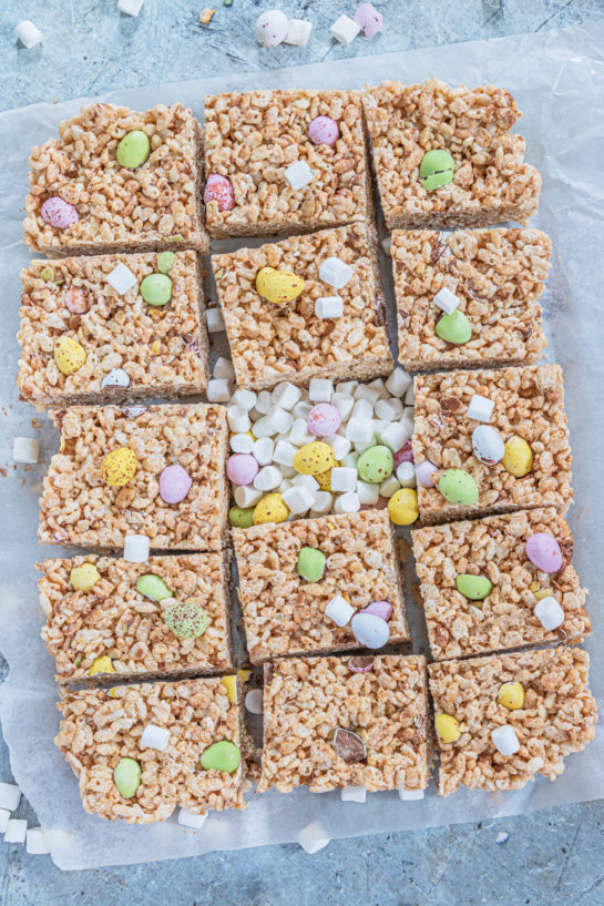 Overhead shot of the cut-up Mini Egg Rice Krispie Treats that are a deliciously addictive dessert recipe for Easter! They're super easy and fun to make with kids. The perfect Easter sweet treat!