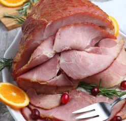 This recipe for Glazed Spiral Ham with a sweet glaze uses a fully-cooked ham and is a great centerpiece for your Christmas, Easter, or Thanksgiving dinner table! The flavor and texture will be a show-stopper!