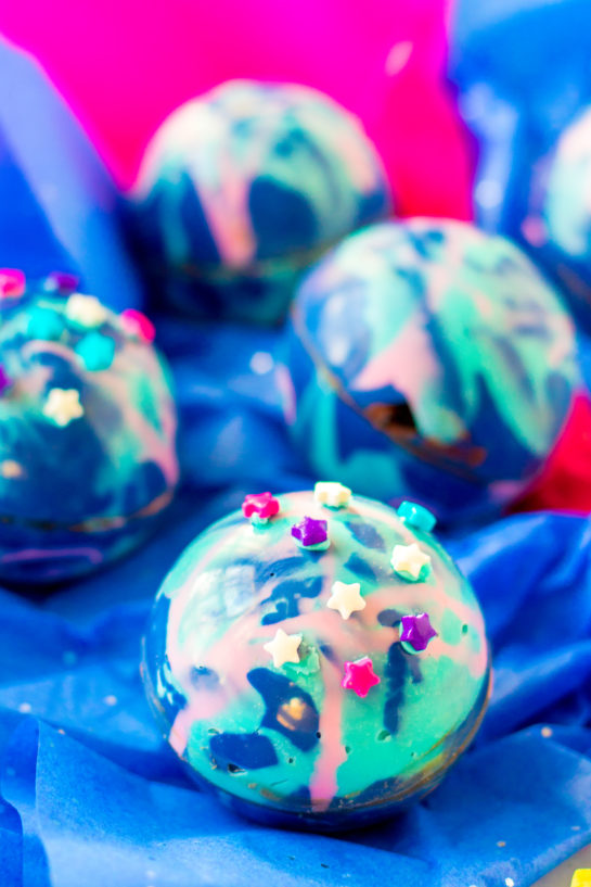 Close-up shot of the finished Galaxy Hot Chocolate Bombs recipe ready to be served at a party