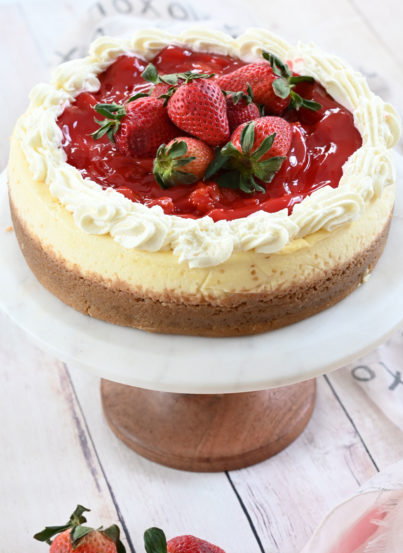 This silky smooth Strawberry Topped New York-Style Cheesecake recipe is the perfect combination of tangy cheesecake and sweet summer berries! It also looks beautiful on your table!