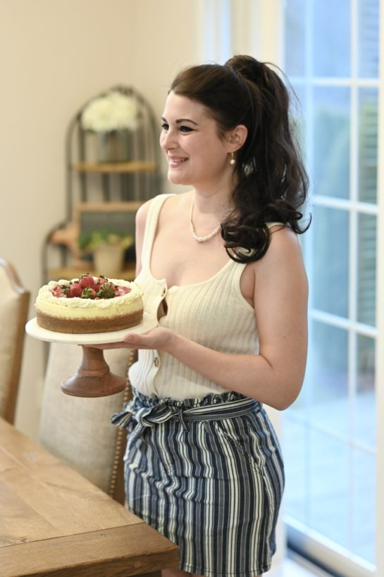 Shot of me holding the Strawberry Topped New York-Style Cheesecake