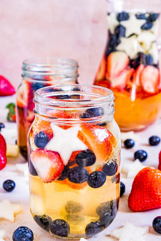 Enjoy my Red, White & Blue Sangria recipe this summer to enjoy a cocktail while beating the heat at the same time! With fresh blueberries, strawberries, white grape juice, brandy, and wine, it's perfect for Flag Day, 4th of July or Memorial Day!