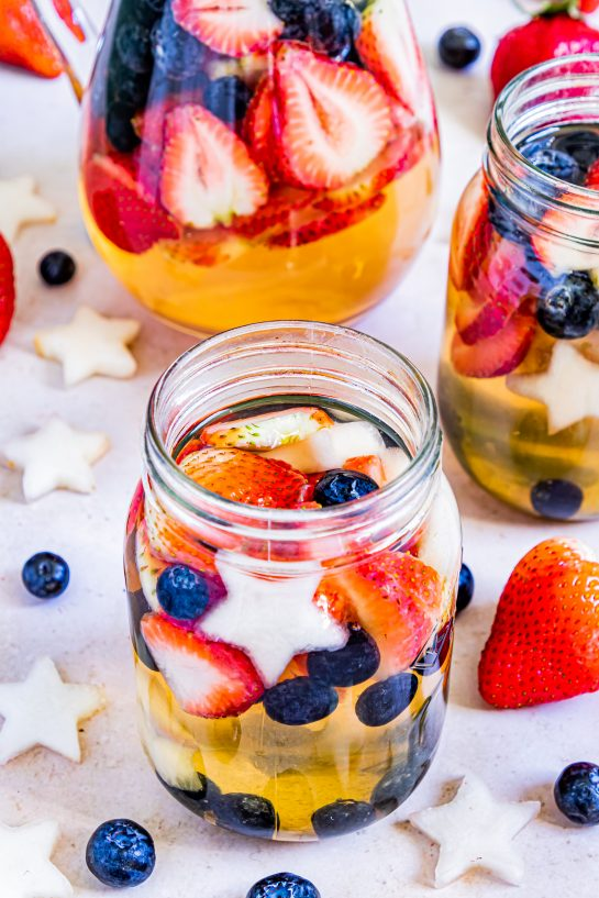 Enjoy my Patriotic Sangria recipe this summer to enjoy a cocktail while beating the heat at the same time! With fresh blueberries, strawberries, white grape juice, brandy, and wine, it's perfect for Flag Day, 4th of July or Memorial Day holiday!