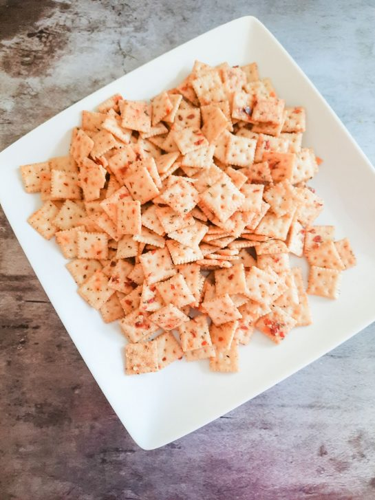 Spicy Alabama Fire Crackers that is an easy snack mix recipe with a kick! This makes for a perfect potluck recipe or party snack everyone will devour!