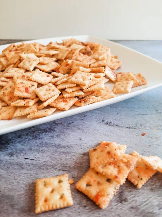 Spicy Alabama Fire Crackers is an easy snack mix recipe with a kick! This makes for a perfect potluck recipe or party snack!