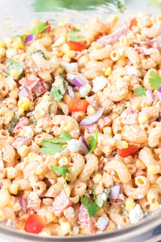 Mixing all ingredients together for the Mexican Street Corn Pasta Salad recipe