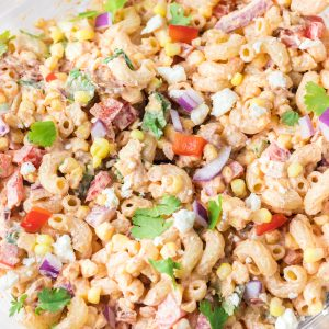 Close-up photo of Mexican Street Corn Pasta Salad is light and healthy, yet so delicious. It's the perfect side or main dish for a big gathering or just a quick meal during the week with a Mexican twist!