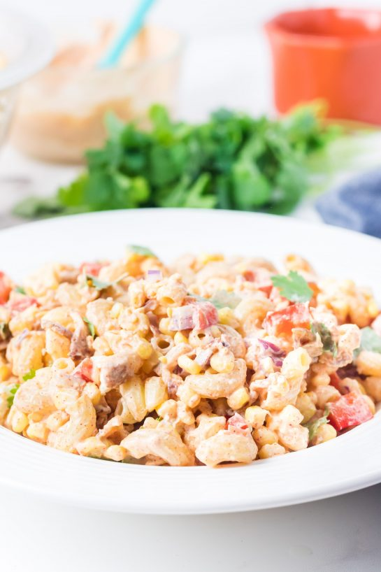 Mexican Street Corn Pasta Salad is light and healthy, yet so delicious. It's the perfect side or main dish for a big gathering or just a quick dinner during the week with a Mexican twist!