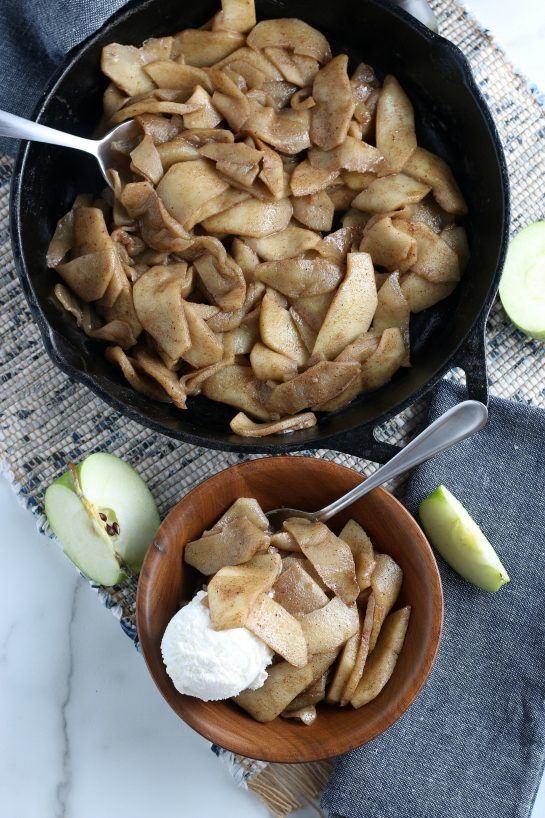 Easy Fried Apples are fresh apple wedges cooked up in butter, sugar and cinnamon until soft and browned. An easy side dish or dessert option for the fall or Thanksgiving that always gets rave reviews!