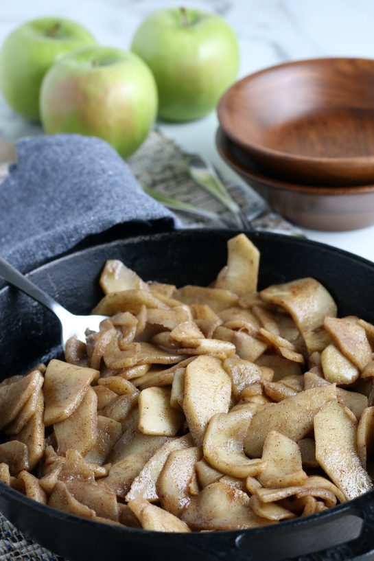 Easy Fried Apples are fresh apple wedges cooked up in butter, sugar and cinnamon until soft and browned. An easy side dish for Thanksgiving or dessert option for the fall that always gets the best reviews!