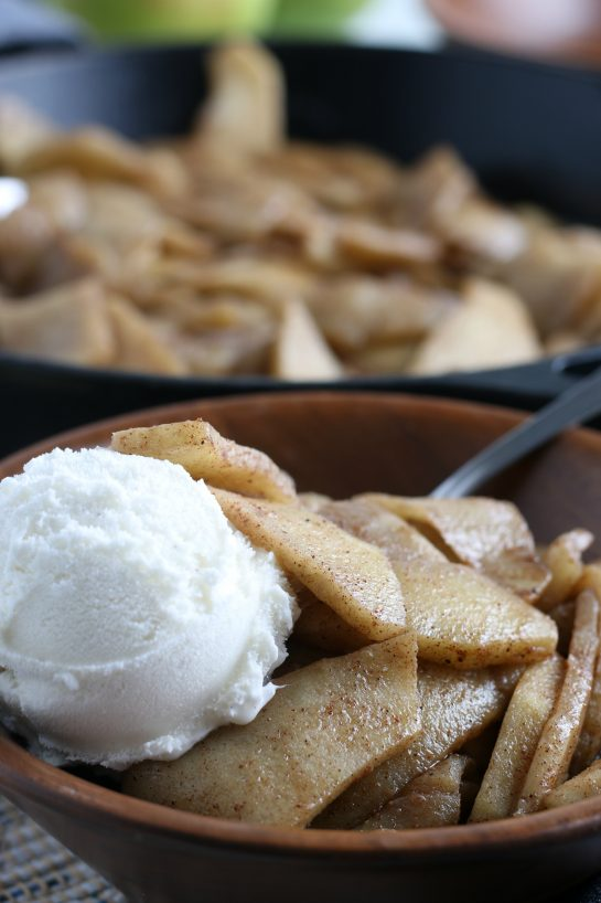 Close-up of easy Fried Apples are fresh apple wedges cooked up in butter, sugar and cinnamon until soft and browned. An easy side dish for Thanksgiving or dessert option for the fall that always gets the best reviews!