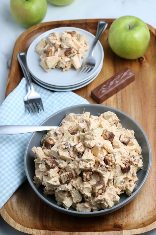Caramel Apple Snickers Salad is a delicious side dish recipe with crunchy green apples, marshmallows, and Snickers candy bars as the main ingredients! Perfect for fall holidays and potlucks!