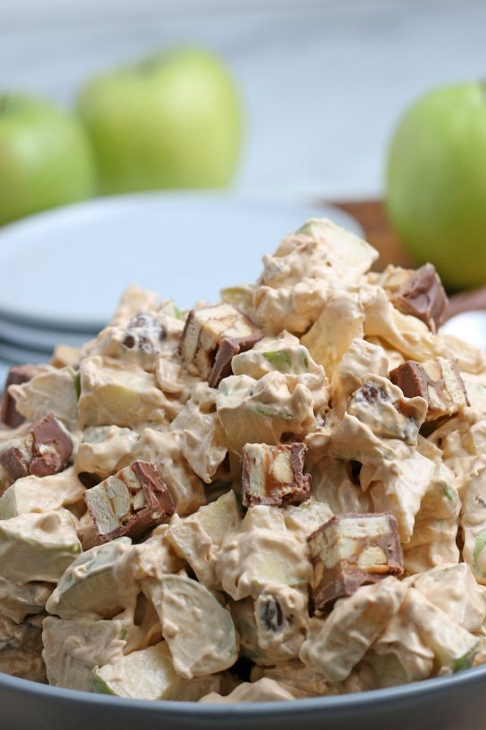 Close-up of the Caramel Apple Snickers Salad is a delicious side dish recipe with crunchy green apples, marshmallows, and Snickers candy bars as the main ingredients! Perfect for fall holidays and potlucks!