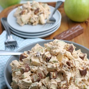 Caramel Apple Snickers Salad is a delicious side dish recipe with crunchy green apples, marshmallows, and Snickers candy bars as the main ingredients! Perfect for holidays and potlucks!
