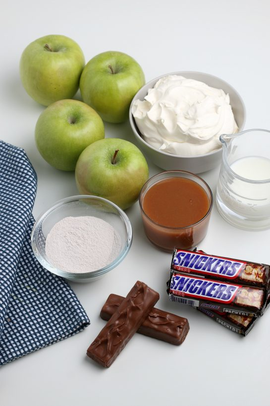 Ingredients needed to make the Caramel Apple Snickers Salad